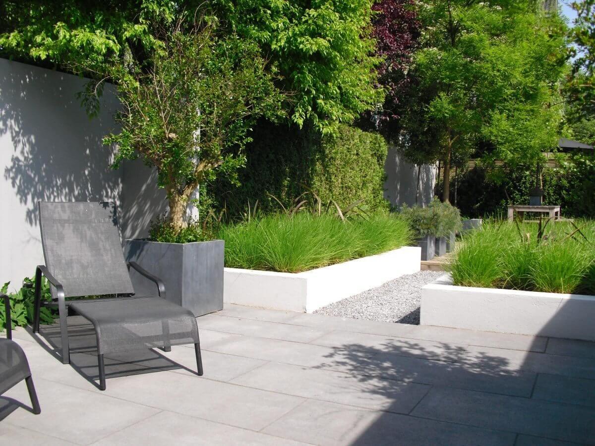 beton tegels grind en grassen hovenier Badhoevedorp