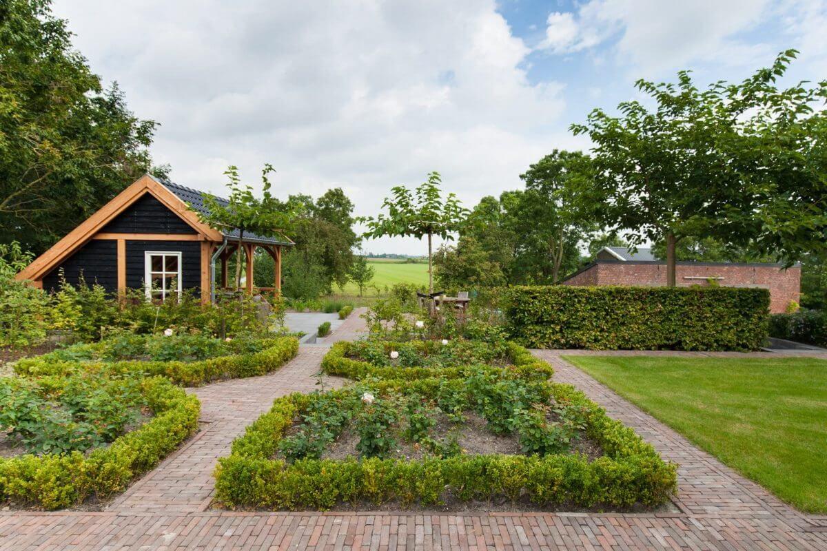 grote tuin terrasoverkapping tuinaanleg hovenier Nederveen Tuinen