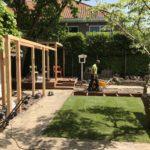 tuin met vijver tuinaanleg pergola kunstgras hovenier Amsterdam