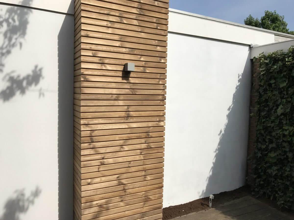 houten wand tuinaanleg verlichting hovenier